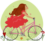 Beautiful young girl rides a Bicycle Royalty Free Stock Photography