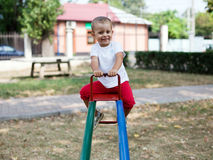 Beautiful young girl on a rocking chair Stock Images