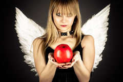 Young girl in the role of tempting angel Stock Photos