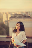 Beautiful young girl at the roof with origami paper crane in hands Royalty Free Stock Photos