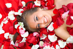Beautiful young girl in rose petal Stock Photo