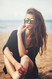 Beautiful Young Girl On The Sand Beach With Sunglasses Royalty Free Stock Photo