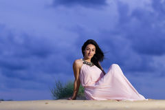 Beautiful young girl on a sand dune Royalty Free Stock Photos