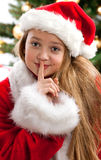 Beautiful young girl in Santa Claus clothes Stock Image