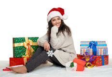 Beautiful young girl in santa hat with big snowflake toy and gif Stock Photos