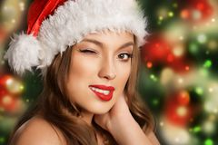Beautiful young girl in santa hat Royalty Free Stock Image
