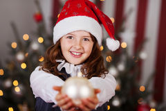 Beautiful young girl in a Santa hat Stock Images