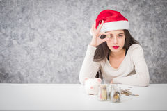 Beautiful young girl saving money for holiday season, saving. Money concept royalty free stock image