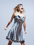 Beautiful young girl screaming anger. Beautiful young caucasian woman girl evening dress screaming angry on studio isolated plain background Royalty Free Stock Images