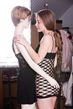 Beautiful young girl sensually embraces the female mannequin Stock Photography