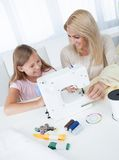 Beautiful Young Girl Sewing With Her Mother Royalty Free Stock Image