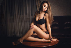 Beautiful young girl in a sexy lingerie Stock Photos