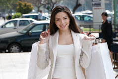 The beautiful young girl with a shopping Bag Royalty Free Stock Images