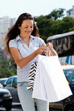 The beautiful young girl with a shopping Bag Royalty Free Stock Photo