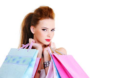 Beautiful young girl with shopping bags Royalty Free Stock Photos