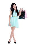 Beautiful young girl with shopping bags. Beautiful young girl in studio standing holding shpping bags -and smiling Stock Photo