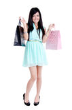 Beautiful young girl with shopping bags. Beautiful young girl in studio standing holding shpping bags -and smiling Stock Photos
