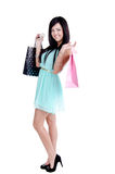 Beautiful young girl with shopping bags. Beautiful young girl in studio standing holding shpping bags -and smiling Royalty Free Stock Images