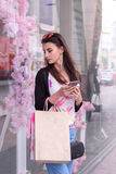 Beautiful young girl with shopping bags at the supermarket Royalty Free Stock Photography