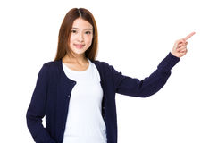 Beautiful young girl showing copy space Stock Photography