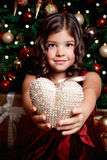 Beautiful young girl showing a heart Stock Image