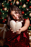 Beautiful young girl showing a heart Royalty Free Stock Photos