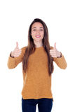 Beautiful young girl showing ok sign with his thumbs. Isolated on a white background Stock Photos
