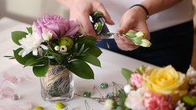 Beautiful young girl shows florist master class on making prekrassnogo bouquet of fresh flowers Stock Images