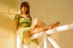 A beautiful young girl sits on rails Royalty Free Stock Photos