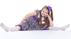 A beautiful young girl sits on a twine. Royalty Free Stock Image