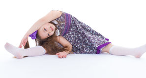 A beautiful young girl sits on a twine. Royalty Free Stock Photo