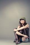 Beautiful young girl sitting Stock Image