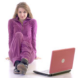 Beautiful young girl sitting on flor near lap top Royalty Free Stock Photo