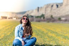Beautiful Young Girl Sitting on the Grass Outdoor stock photography