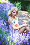 Beautiful Young Girl Sitting Near Blooming Lavender Stock Image
