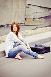 Beautiful young girl sitting on road Royalty Free Stock Photo