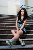 Beautiful young girl sitting on stairs Stock Photos