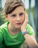 Beautiful Young Girl Sitting In The Wind Outside Royalty Free Stock Photos