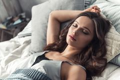 Girl in bed. Beautiful young girl is sleeping in bed at home Royalty Free Stock Images