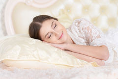 Beautiful young girl sleeping in bed Royalty Free Stock Photography