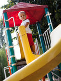 Beautiful young girl on a slide Stock Photos