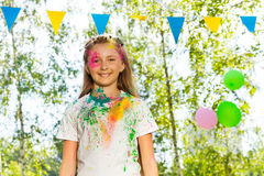 Beautiful young girl smeared with colored powder Stock Image