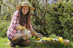 Beautiful young girl smiles in her garden Royalty Free Stock Photos