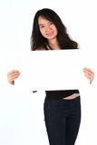 Beautiful young girl smiling holding blank card Stock Image