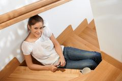 Beautiful young girl smiling at staircase Royalty Free Stock Image