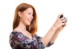 Beautiful young girl smiling and taking a photo Stock Photos