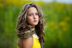 Beautiful young girl with snake Royalty Free Stock Images