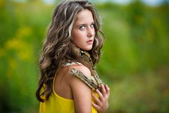 Beautiful young girl with snake Stock Photo