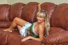 Beautiful young girl on  sofa Stock Photos