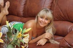 Beautiful young girl on  sofa Stock Image